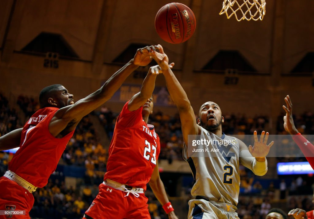 Jevon Carter #2 of the West Virginia Mountaineers in action against Jarrett Culver #23 of the Texas Tech Red Raiders and Brandone Francis #1 of the Texas Tech Red Raiders at the WVU Coliseum on February 26, 2018 in Morgantown, West Virginia.