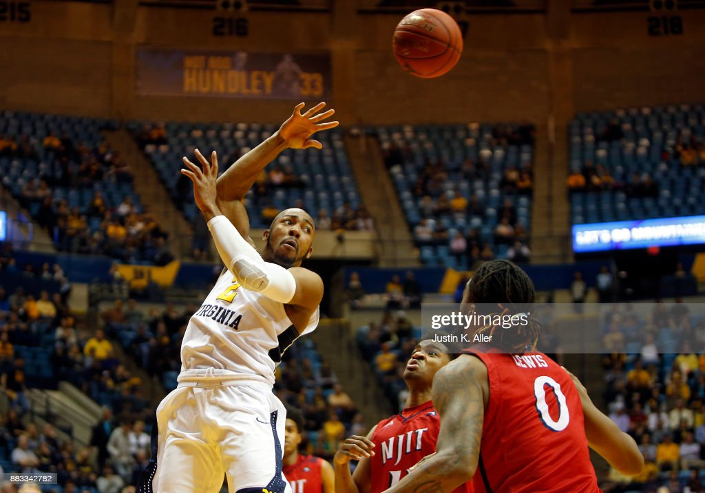 Jevon Carter #2 of the West Virginia Mountaineers makes a pass against the N.J.I.T Highlanders at the WVU Coliseum on November 30, 2017 in Morgantown, West Virginia.