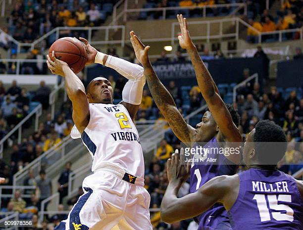 Jevon Carter of the West Virginia Mountaineers pulls up for a shot against against the TCU Horned Frogs during the game at the WVU Coliseum on...