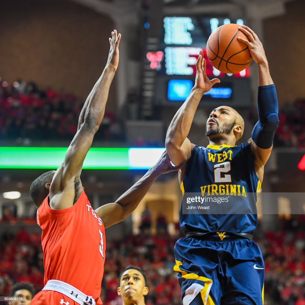 Jevon Carter #2 of the West Virginia Mountaineers shoots the ball over Josh Webster #3 of the Texas Tech Red Raiders Raiders during the game on January 13, 2018 at United Supermarket Arena in Lubbock, Texas. Texas Tech defeated West Virginia 72-71.