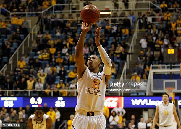 Jevon Carter of the West Virginia Mountaineers shoots the game winning foul shot in overtime against the TCU Horned Frogs during the game at the WVU...