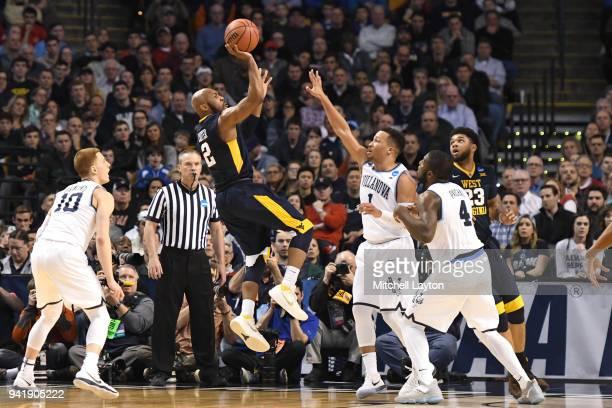 Jevon Carter of the West Virginia Mountaineers takes a shot over Jalen Brunson of the Villanova Wildcats during the 2018 NCAA Men's Basketball...