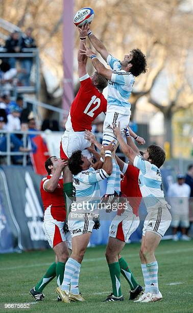 Jevon Groves of Wales and Mariano Baud of Argentina fight for the ball during a lineout during the IRB Sevens World Series at Sam Boyd Stadium...