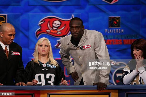 Jevon Kearse of the Philadelphia Eagles eyes the board with his favorite Eagles fan during the Wheel of Fortune NFL Players Week taping on December 7...