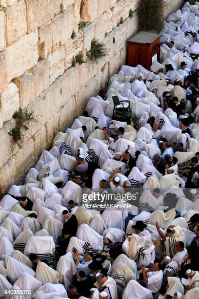 Jew priests wearing Talit and civilians take part in the Cohanim prayer during the Passover holiday at the Western Wall in the Old City of Jerusalem...