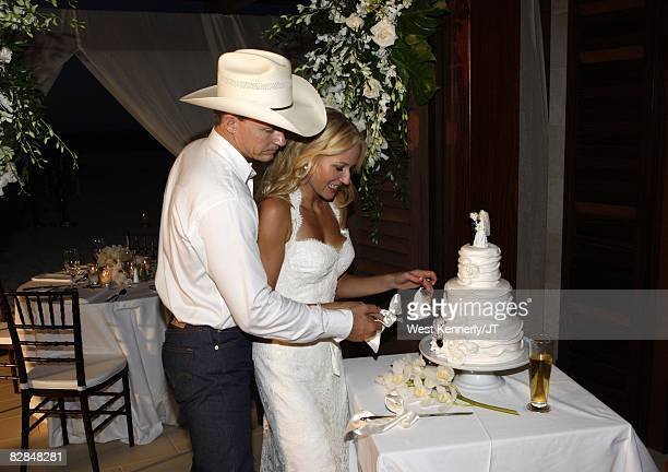 ACCESS** Jewel and Ty Murray cut the wedding cake during their reception dinner at Atlantis Resort on August 7 2008 on Paradise Island in Nassau...
