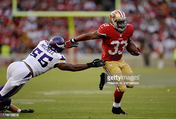 Jewel Hampton of the San Francisco 49ers carries the ball running away from Marvin Mitchell of the Minnesota Viking in the third quarter at...
