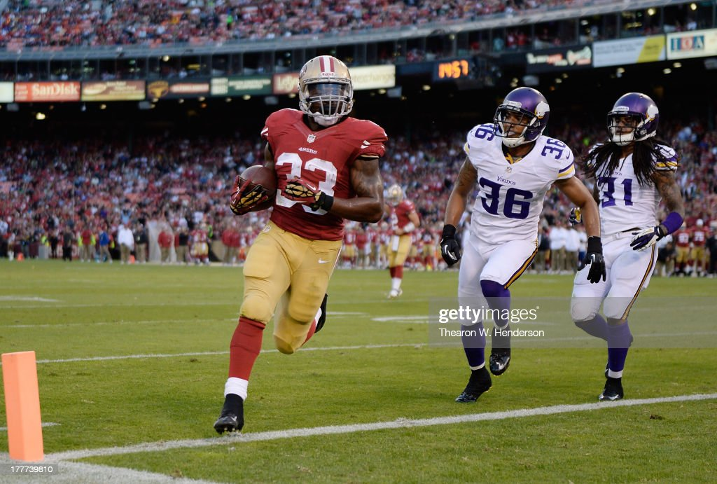 Jewel Hampton #33 of the San Francisco 49ers rushes for a three yard touchdown pursued by Robert Blanton #36 and Bobby Felder #31 of the Minnesota Viking in the fourth quarter at Candlestick Park on August 25, 2013 in San Francisco, California. The 49ers won the game 34-14.