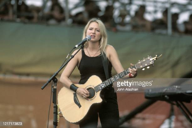 Jewel is shown performing on stage during her concert performance at Woodstock 99 on July 25, 1999.