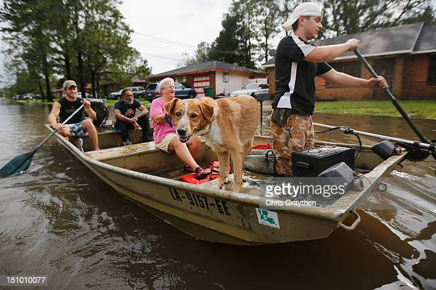 Jewel Rico and her dog Chico are rescued from flood waters from Hurricane Isaac on August 30 2012 in Reserve Louisiana Isaac downgraded Wednesday to...