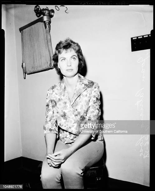 Jewel robbery suspects, 26 September, 1958. Joan Patrician Rose - 26 years ;Officer W.A Valentine;Stanley P McGinnis ;Stolen Jewels.;Caption slip...
