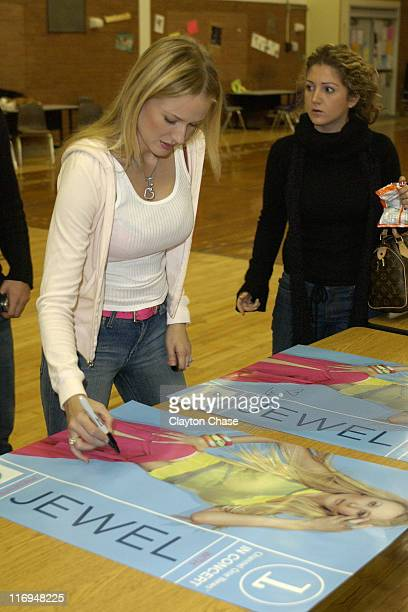 Jewel signing posters during Jewel special appearance and Channel One benefit concert at Lehi High School in Lehi Utah United States