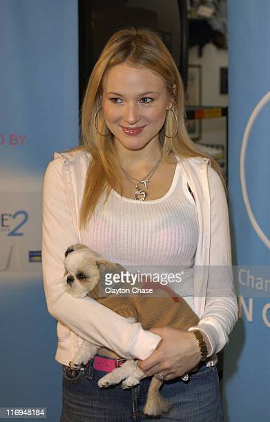 Jewel with dog George during Jewel special appearance and Channel One benefit concert at Lehi High School in Lehi Utah United States