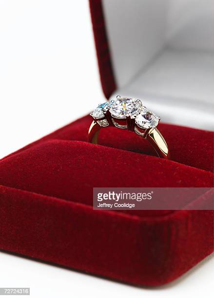 jeweled engagement ring in display box, close-up - engagement ring box stock photos and pictures