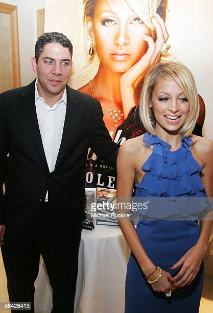 Jeweler Brian Ripka and writer Nicole Richie attends the celebration of her novel The Truth About Diamonds at Judith Ripka on December 13 2005 in Los...