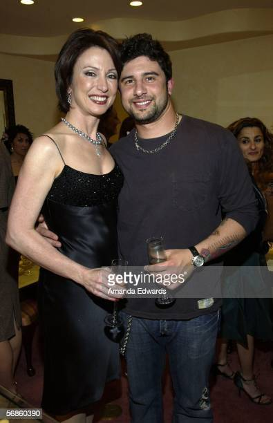 Jeweler Erica Courtney and her son Josh attend a Pre-Oscar viewing party at Courtney's showroom on February 15, 2006 in Los Angeles, California.
