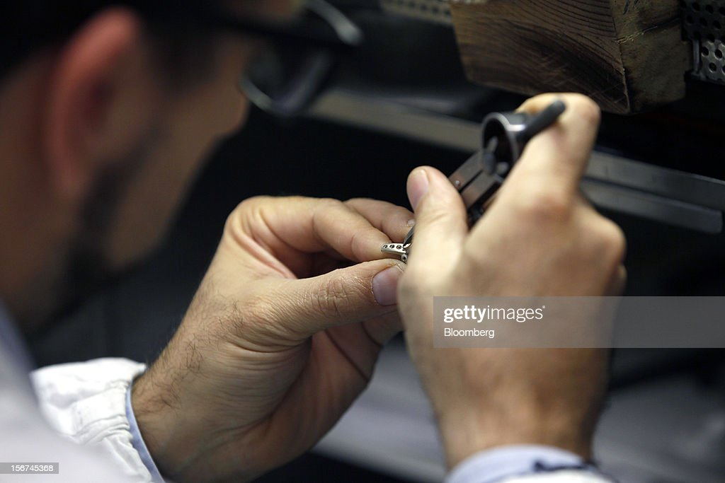 A jeweler works on a white gold ring in Bulgari SpA's jewelry workshop, a luxury unit of LVMH Moet Hennessy Louis Vuitton SA, in Rome, Italy, on Monday, Nov. 19, 2012. Last year's acquisition of Bulgari 'has brought a lot of jewelry know-how' to the company, said Francesco Trapani, president of LVMH's watch and jewelry division, who joined the Paris- based luxury-goods maker as part of the deal. Photographer: Alessia Pierdomenico/Bloomberg via Getty Images