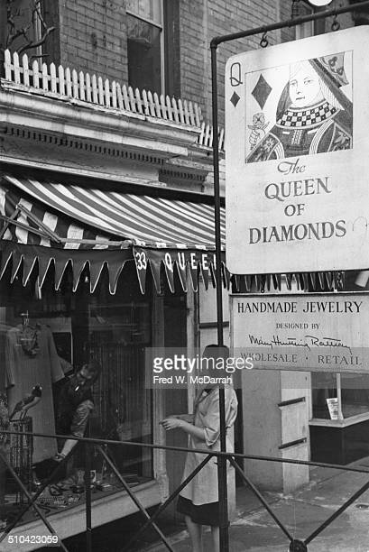 Jewelery designer Mary Rattray Kanovitz directs her husband artist Howard Kanovitz who helps to arrange a window display in her shop Queen of...