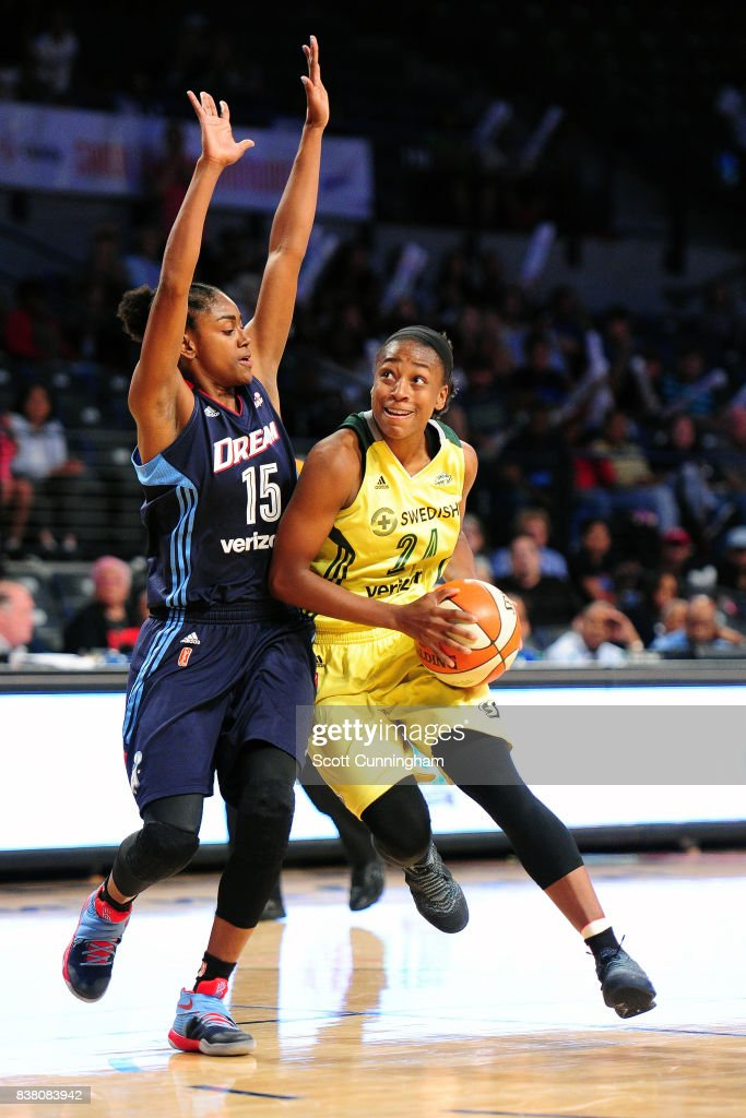 Jewell Loyd #24 of the Seattle Storm handles the ball against Tiffany Hayes #15 of the Atlanta Dream during a WNBA game on August 23, 2017 at Hank McCamish Pavilion in Atlanta, Georgia.