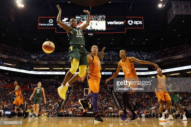 Jewell Loyd of the Seattle Storm looses the ball as she drives past Brittney Griner and DeWanna Bonner of the Phoenix Mercury during game three of...