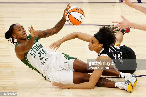 Jewell Loyd of the Seattle Storm passes the ball pressured by Brianna Turner of the Phoenix Mercury during the first half of the WNBA game at Phoenix...