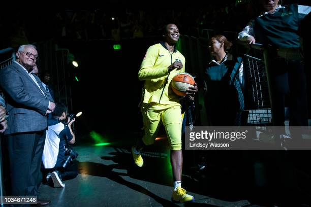 Jewell Loyd of the Seattle Storm smiles as she runs out during introductions before Game 2 of the WNBA Finals at KeyArena on September 9 2018 in...