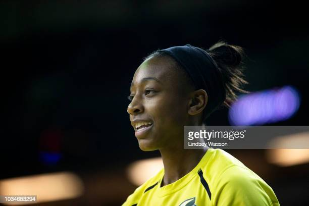 Jewell Loyd of the Seattle Storm smiles as she warms up on the court before Game 2 of the WNBA Finals at KeyArena on September 9 2018 in Seattle...
