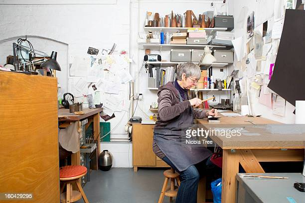 A jeweller working in workshop