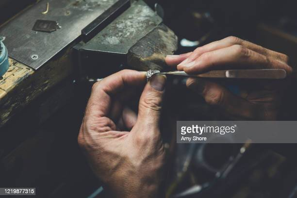 jeweller's hands working on diamond ring - jewellery stock pictures, royalty-free photos & images