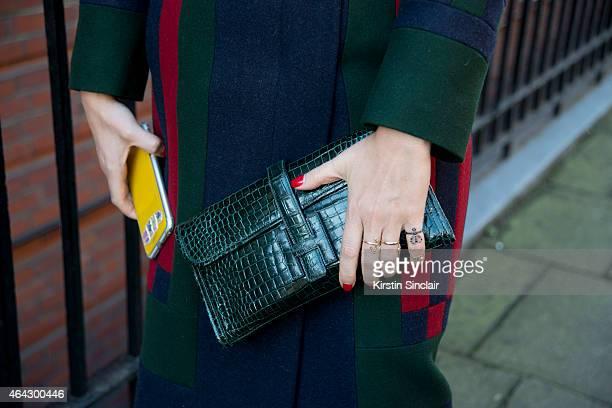 Jewellery and clothing designer Natasha Zinko wears a Tom Browney coat Hermes bag and Natasha Zinko jewellery on February 23 2015 in London England