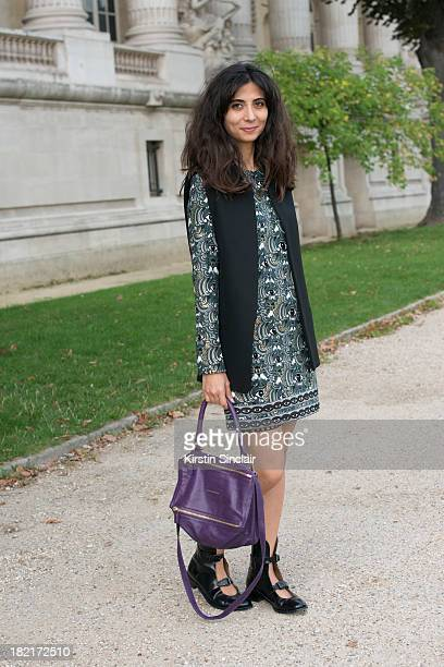 Jewellery designer and fashion blogger Giia Guldal Aydinii wears Kenzo dress Acne shoes Zara waistcoat and a Chanel bag on day 4 of Paris Fashion...