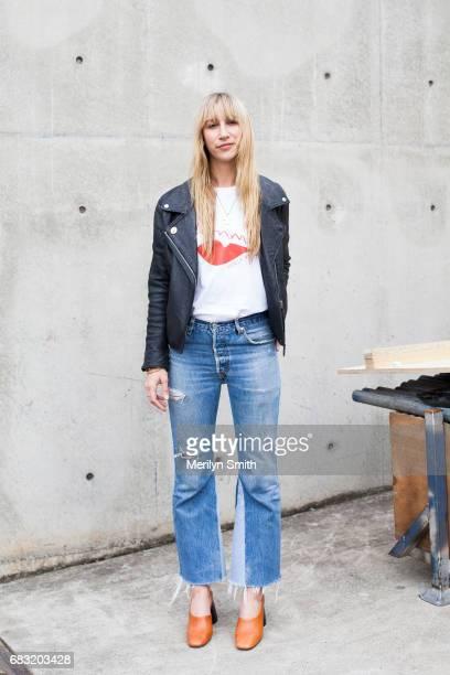 Jewellery Designer Holly Ryan wearing a Holly Ryan tshirt Acne jacket Mango shoes and Holly Ryan jewellery during MercedesBenz Fashion Week Resort 18...