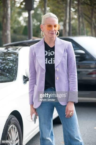Jewellery designer Jennifer Fisher wears a Gucci jacket, Dior T-shirt, Off-White jeans, Jennifer Fisher earrings and Porsche Design sunglasses day 1...