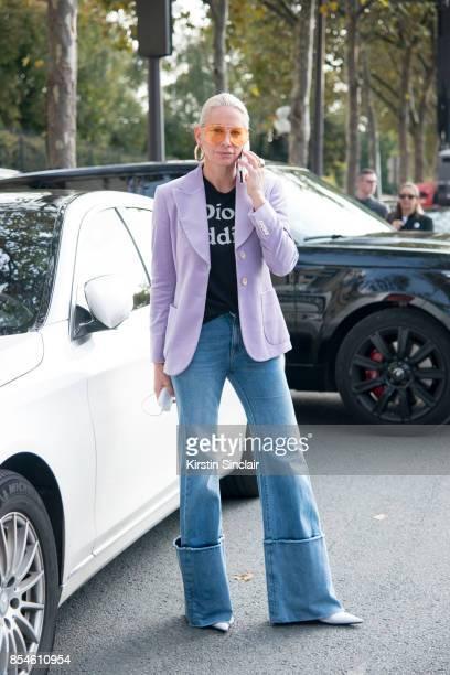 Jewellery designer Jennifer Fisher wears a Gucci jacket, Dior T-shirt, Off-White jeans, Jennifer Fisher earrings, Balenciaga shoes and Porsche Design...