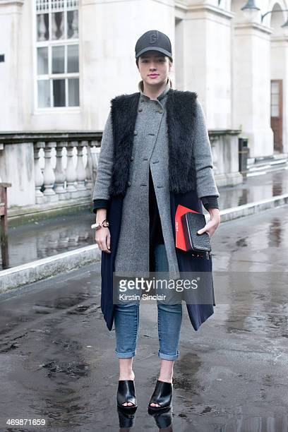 Jewellery designer Maddy Moxham wears a Harrods coat And Other Stories bag Zara waistcoat Gap cap and Cos shoes on day 2 of London Collections Women...