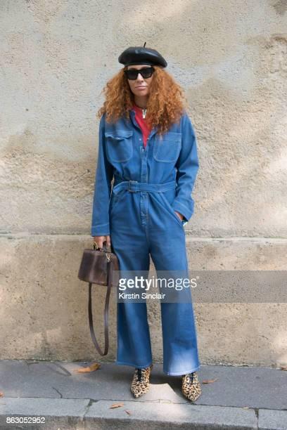 Jewellery designer Natasha Zinko wears a Dior jumpsuit and shoes Celine sunglasses Natasha Zinko bag and jewellery day 1 of Paris Womens Fashion Week...