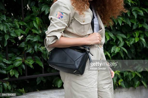 Jewellery designer Natasha Zinko wears a Natasha Zinko jumpsuit and Loewe bag on day 1 of Paris Haute Couture Fashion Week Autumn/Winter 2016 on July...