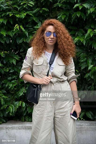 Jewellery designer Natasha Zinko wears a Natasha Zinko jumpsuit Loewe bag and Ray Ban sunglasses on day 1 of Paris Haute Couture Fashion Week...