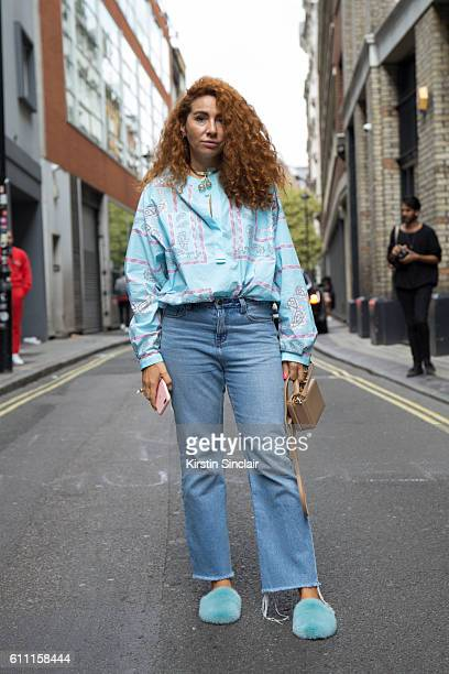 Jewellery designer Natasha Zinko wears vintage trousers Mark Cross bag Natasha Zinko shirt and shoes on day 3 of London Womens Fashion Week...