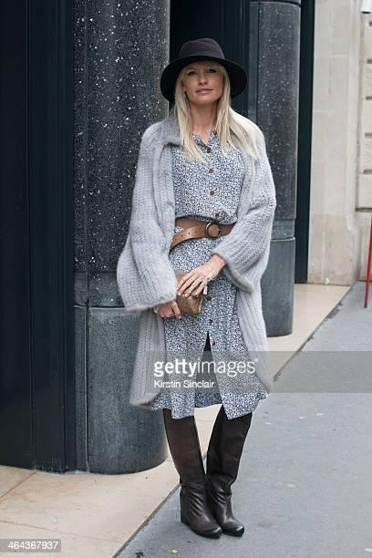Jewellery designer Yana Raskovalova wears a Dior jacket Ulyana Sergeenko dress boots and bag and a Maison Michel hat day 2 of Paris Haute Couture...