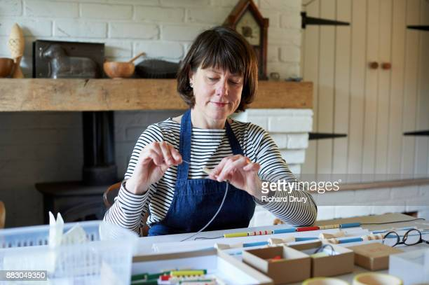 Jewellery maker in her workshop