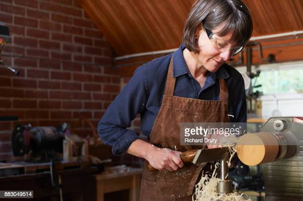 Jewellery maker turning wood on a lathe