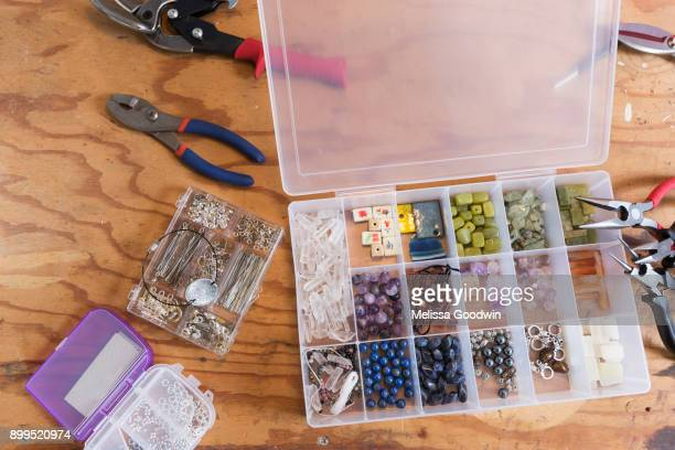 jewellery makers tools on workbench, overhead view - bead stock pictures, royalty-free photos & images