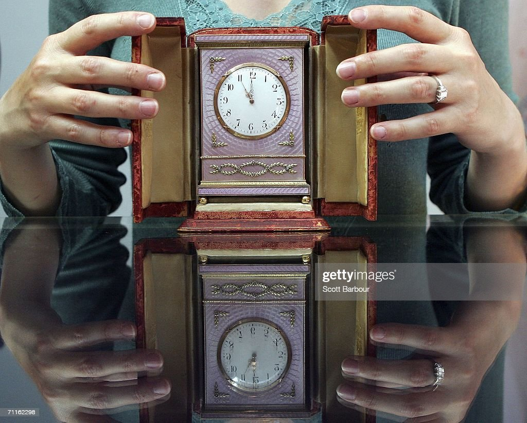 A jewellery specialist from Christie's holds a Faberge clock estimated to fetch between USD$ 1,100,000 to 1,300,000 during a photocall of jewellery and works of art from the Collection of Her Royal Highness The Princess Margaret, Countess of Snowdon at Christie's on June 9, 2006 in London, England. Jewellery and and works of art of Princess Margaret, sister of Queen Elizabeth II, will be auctioned off on June 13 and 14.