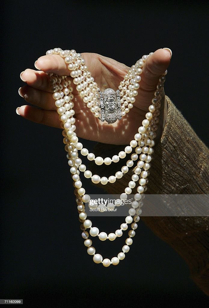 A jewellery specialist from Christie's holds an Art Deco Pearl and Diamond Necklace during a photocall of jewellery and works of art from the Collection of Her Royal Highness The Princess Margaret, Countess of Snowdon at Christie's on June 9, 2006 in London, England. The necklace was given to Princess Margaret by her grandmother Her Majesty Queen Mary for her 18th birthday and is expected to fetch USD$26,000 to 35,000. Jewellery and and works of art of Princess Margaret, sister of Queen Elizabeth II, will be auctioned off on June 13 and 14.