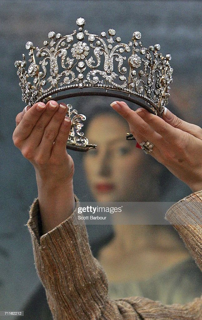 A jewellery specialist from Christie's holds the 'Poltimore Tiara' in front of a painting of Princess Margaret during a photocall of jewellery and works of art from the Collection of Her Royal Highness The Princess Margaret, Countess of Snowdon at Christie's on June 9, 2006 in London, England. The Princess wore the Tiara on severlal occasions including her wedding and it is expected to betch between USD$275,000 to 370,000. Jewellery and and works of art of Princess Margaret, sister of Queen Elizabeth II, will be auctioned off on June 13 and 14.