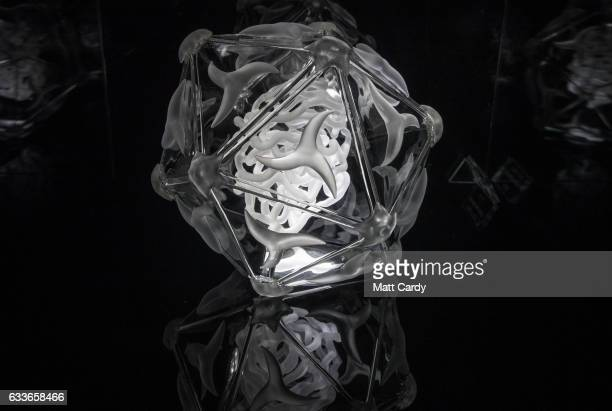A jewellike sculpture of the EV71 Hand Foot and Mouth virus which forms part of the Glass Microbiology exhibition that aims to brings the invisible...