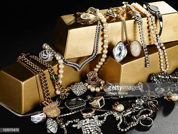 jewelry and gold bars - diamond gemstone stock pictures, royalty-free photos & images