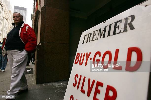 Jewelry dealers wait outside of a store that buys gold April 21 2006 in New York City The price of gold rose to $63260 a troy ounce Wednesday the...