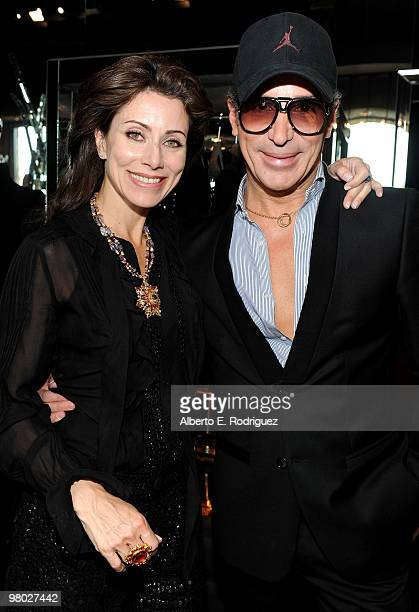 Jewelry designer Angela TassoniNewley and fashion designer Lloyd Klein pose at 'A Parisian Afternoon' hosted by The House of Lloyd Klein Couture on...